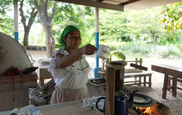 Women dressed with Cost Rica Typical costume brewing some coffee at el viejo cultural activities