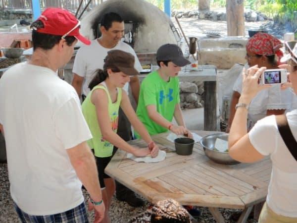Kids cooking tortillas at el Viejo cultural activities Guanacaste Costa Rica